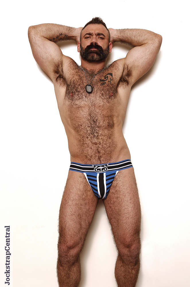 Hairy man rainbow thong